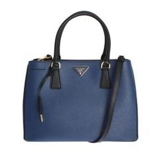 2abcf7c1341a Trending product! This item has been added to cart 23 times in the last 24  hours. PRADA Saffiano ...