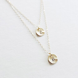 Two Gold Multi Length Initial Charms Necklace