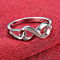 Simulated CZ Diamond Infinity Ring in 18K White Gold